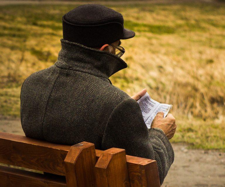 Senior Debt Crisis man sitting on bench